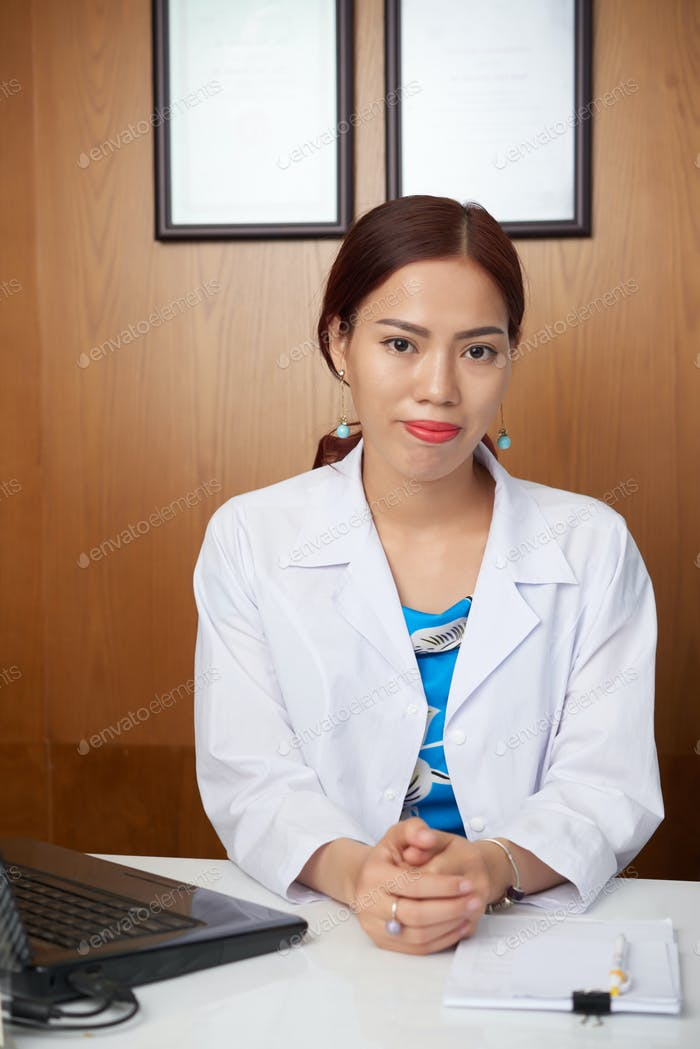 Medical professional sitting at office