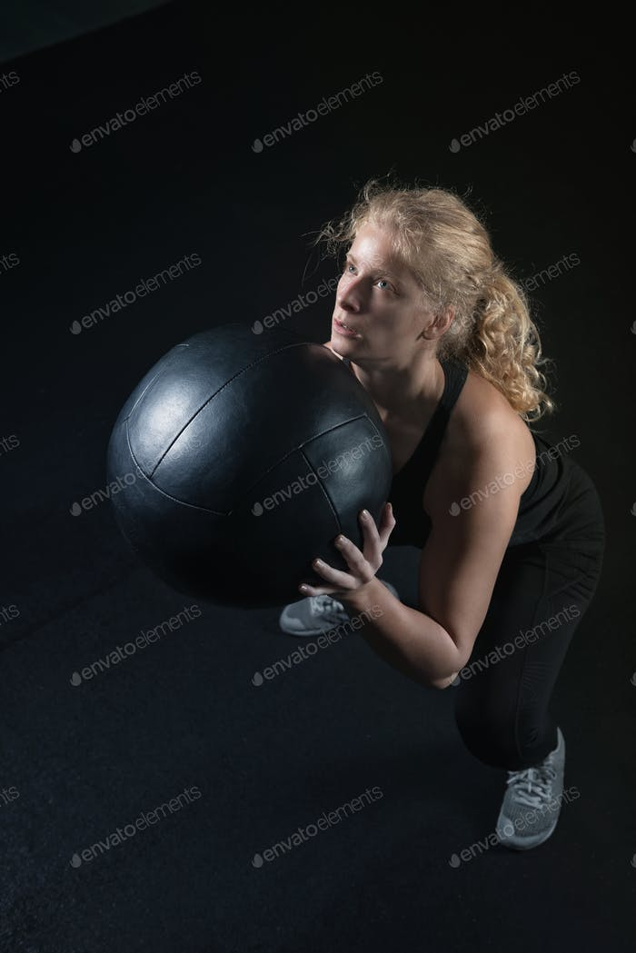 Exercise With Medicine Ball At Gym