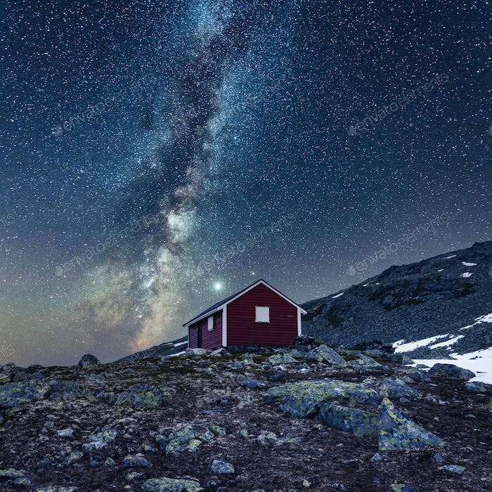 Fantastic landscape with norwegian red wooden house