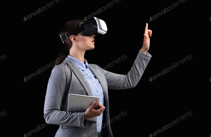 Business Lady In VR Headset Pressing Invisible Button, Black Background