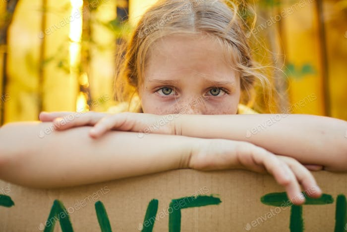 Cute Freckled Girl Hiding Behind Sign