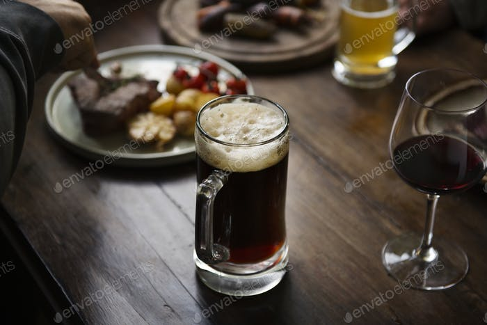 Closeup of a dinner table with alcohol