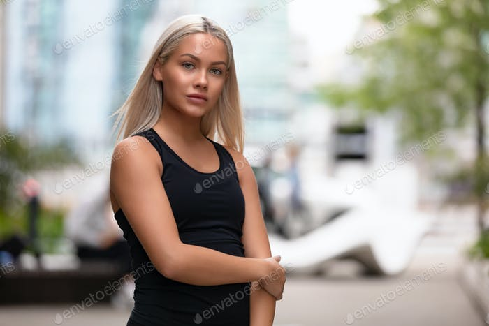 Portrait of a beautiful young woman fitness model looking at camera
