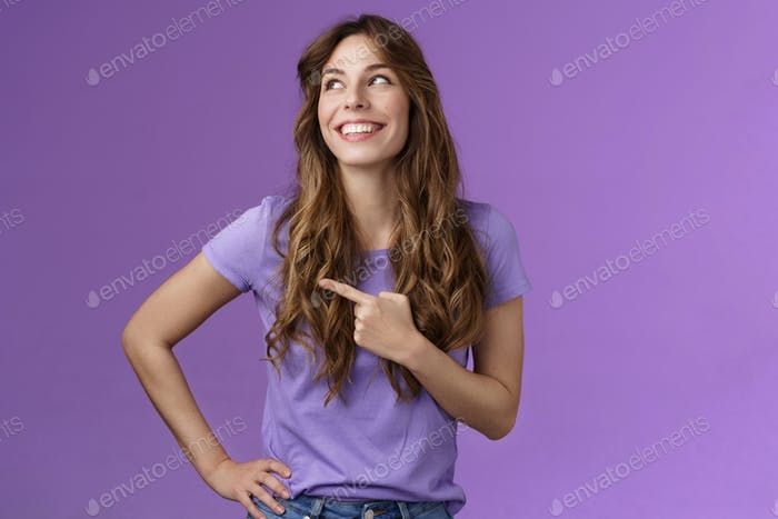 Cheerful motivated enthusiastic upbeat curly-haired girl turn left pointing sideways contemplate