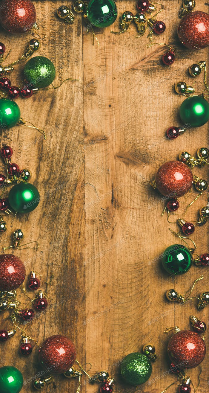Christmas tree decoration balls on wooden background, vertical composition