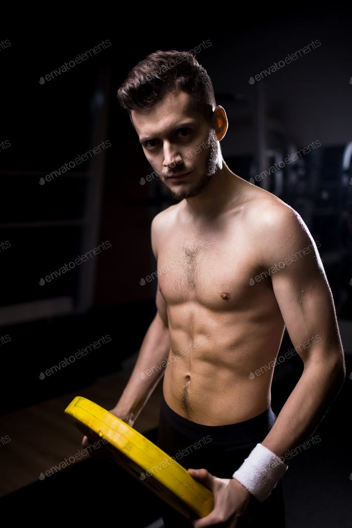 Guy exercising with disk