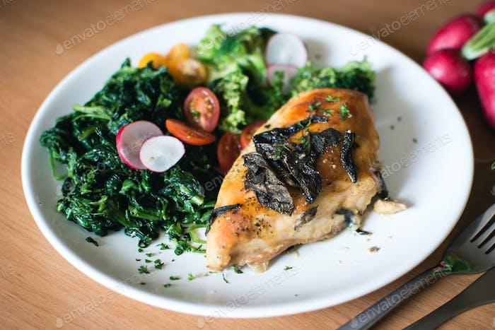 Roasted chicken breasts with spinach and sage
