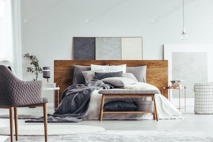 Bench in cozy bedroom interior