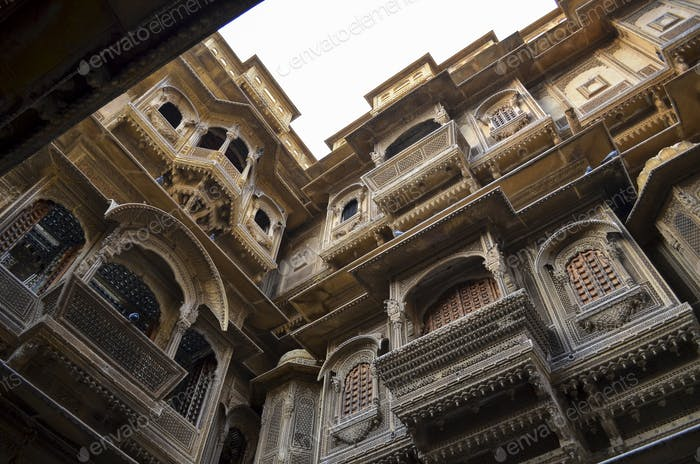 View up from the ground inside a haveli in Jaisalmer. Traditional architecture, windows and