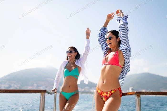 Sexy women friends enjoying summer vacation on the beach