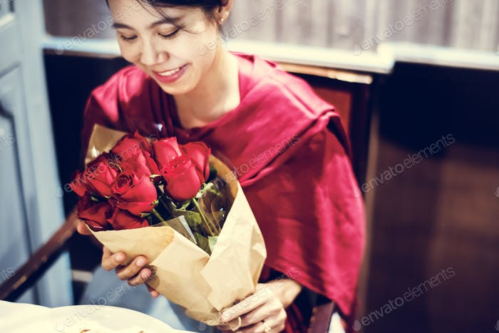 Woman got red rose bouquet