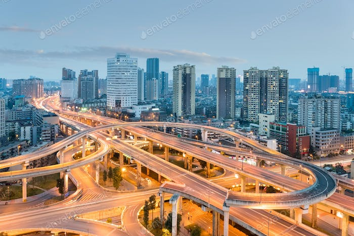 urban overpass at dusk, modern city skyline and traffic background