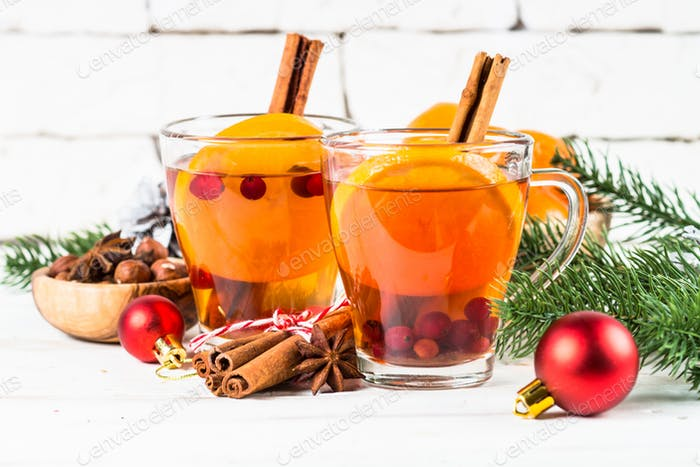 Winter hot tea with orange, cranberry and spices