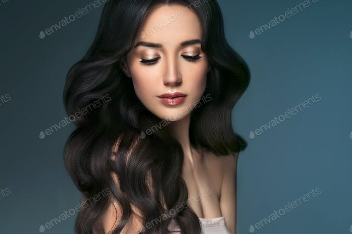 Beautiful woman with long hair, shine and curly, beauty girl female over darl gray background