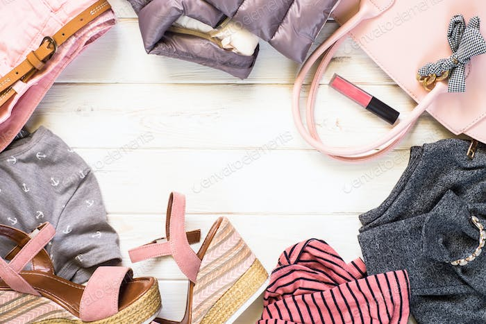 Woman clothes and accessories in pink and gray colors