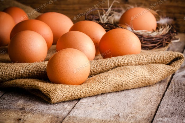 Fresh farm eggs on sacking