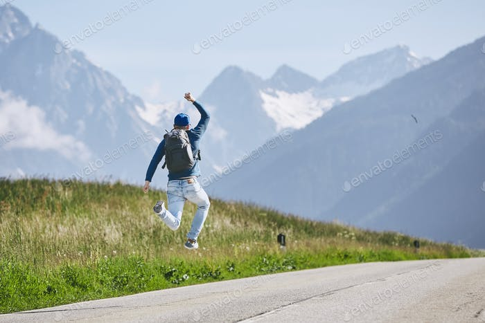 Happy traveler in mountains
