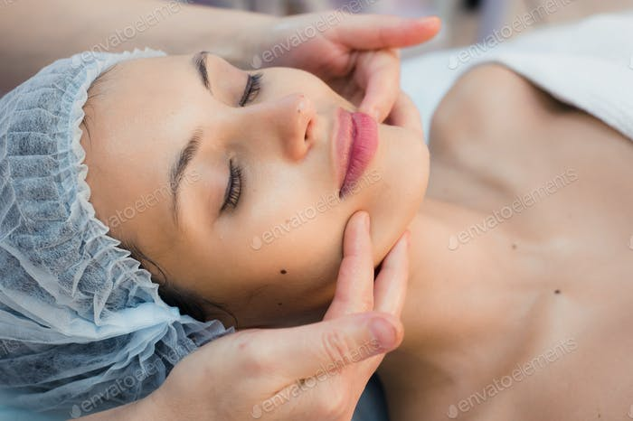 Young, beautiful and healthy woman in spa salon. Traditional oriental massage therapy, beauty