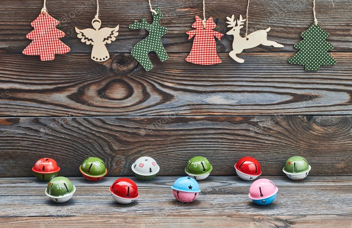 Christmas decoration hanging on wooden background