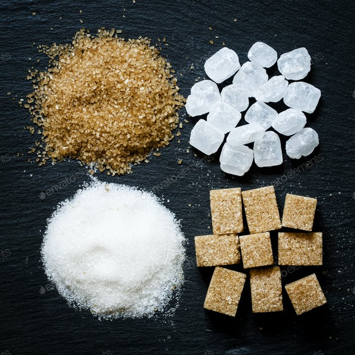 Assortment of sugar: white sand, candy sugar, brown sugar into pieces and brown sugar
