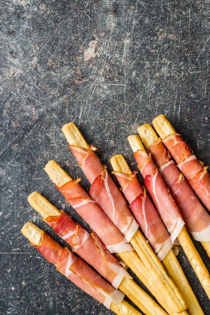 Parma ham prosciutto with grissini breadsticks.