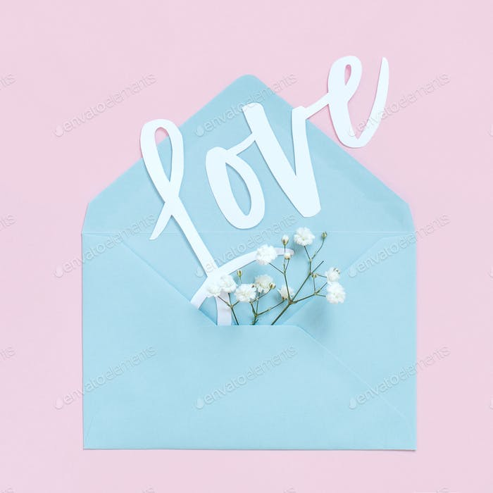 Flowers, envelope and word LOVE on a light pink background