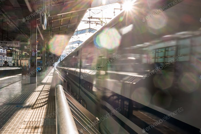 Shinkansen train arriving at station, Tokyo, Japan