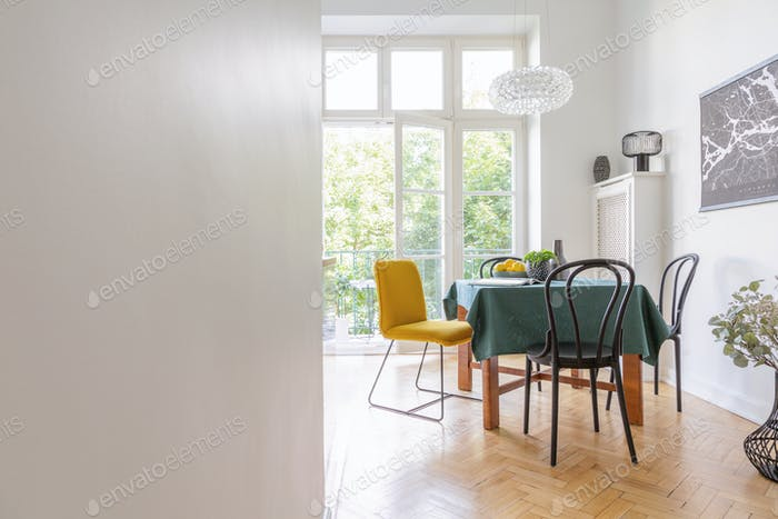 Living room interior with long table with green table cloth and