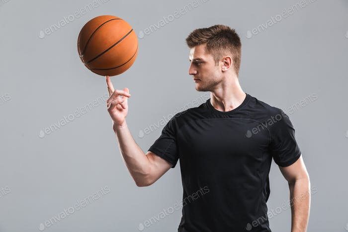 Portrait of a young sportsman playing basketball