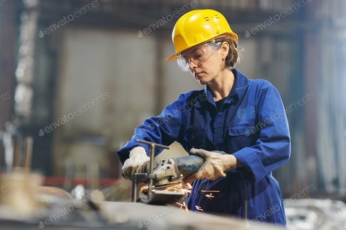 Strong Woman Working in Garage