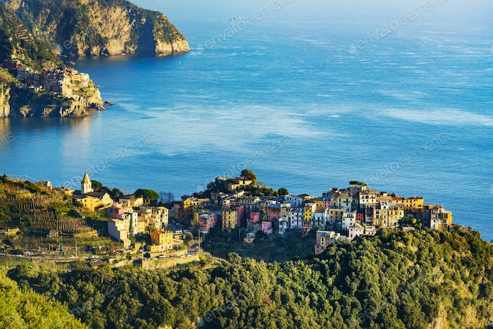 Corniglia village and Manarola in background at sunset. Cinque T