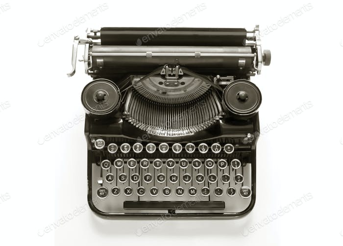 Antique typewriter against a crisp white backdrop.