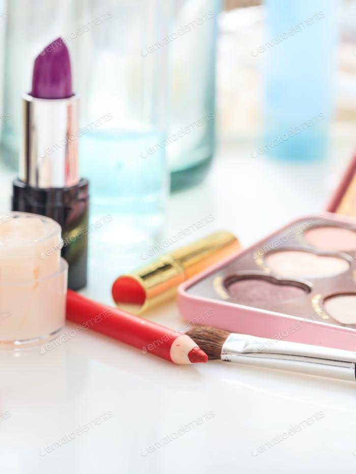 Set of makeup cosmetics background. Vertical photo.