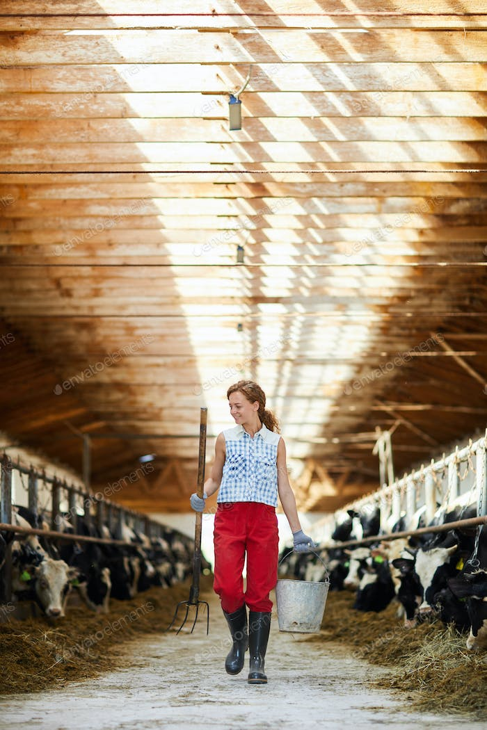 Female Farmer in Cowshed
