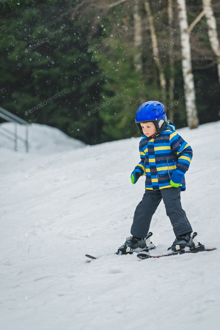 Little boy skiing for the first time