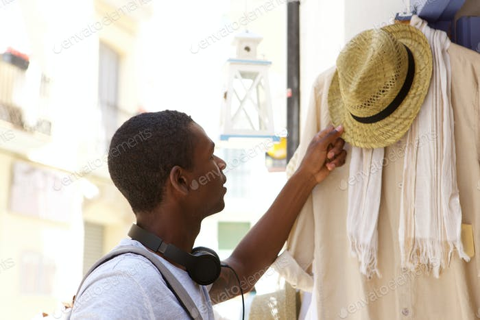 Young african american man shopping for clothes