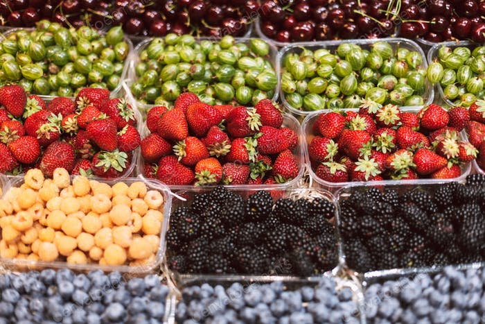 Close up stand with variety of beautiful fresh fruits in grocery