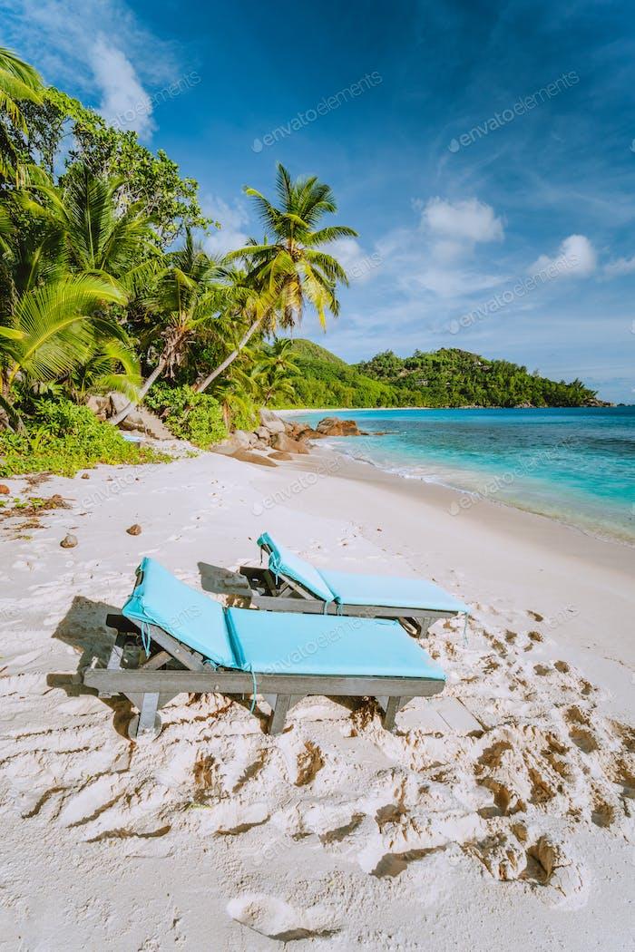 Mahe, Seychelles. Two sun lounger at beautiful Anse intendance beach. Blue ocean, white sand and