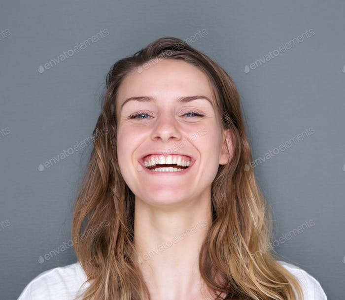 Cheerful young woman laughing