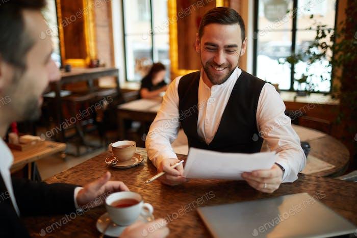 Business Partners Negotiating Deal in Restaurant