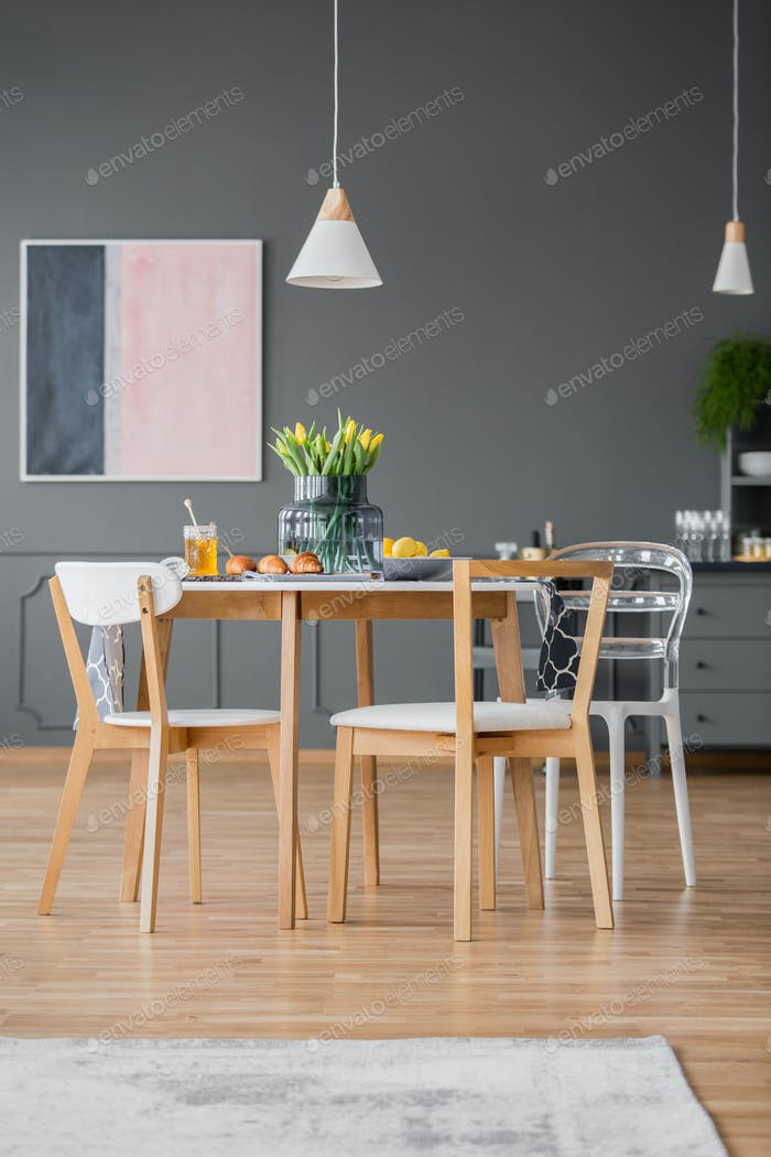 Modern dining chairs around table