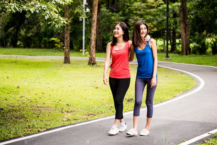 Attractive young women walking after exercise in a park