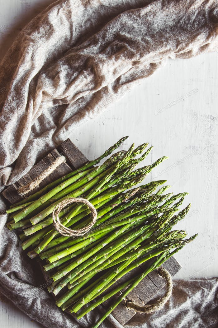 Green asparagus on an old wight table