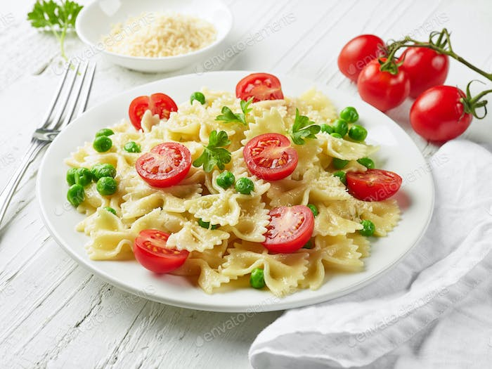 plate of pasta with cheese and vegetables