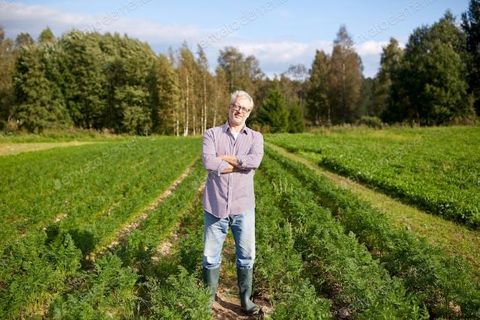 happy senior man at farm