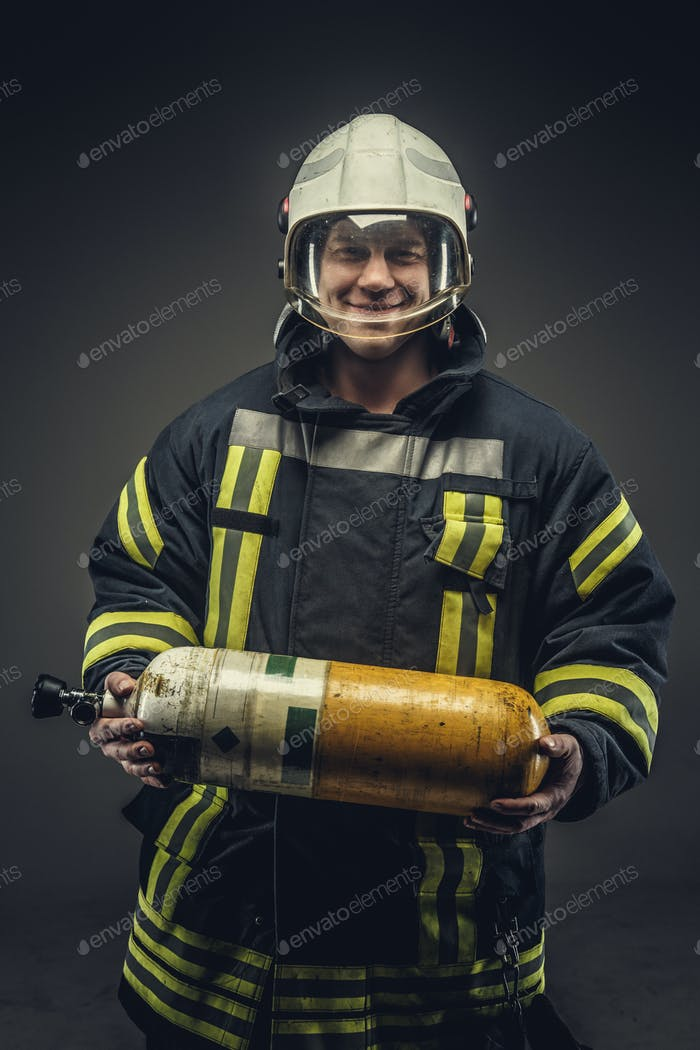 Portrait of firefighter in safety uniform.