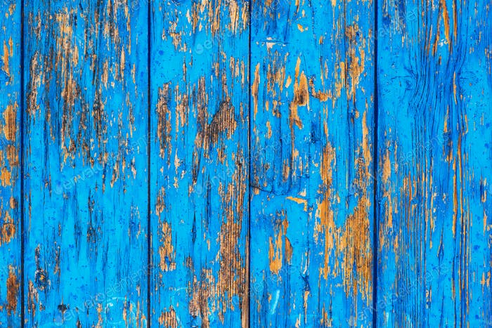 Blue weather worn wooden texture with paint peeling off