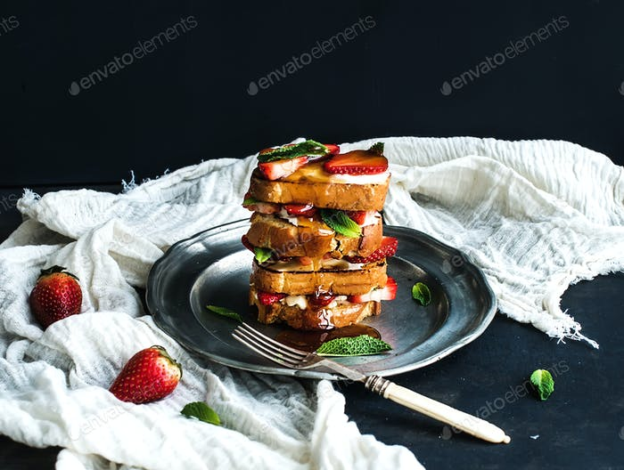 French toasts tower with strawberry, cream cheese, honey and mint