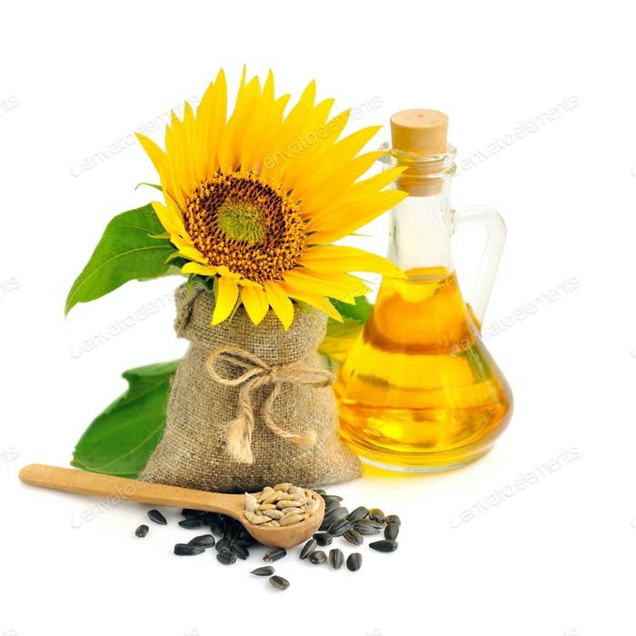Wooden spoon with sunflower seeds on a background of small bag w