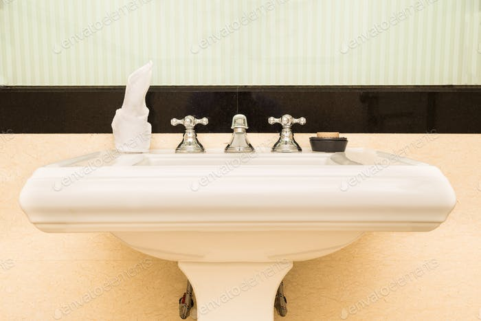 Contemporary and elegant wash basin sink in toilet